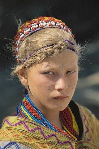 girl from kalash pakistan with facial tattoos